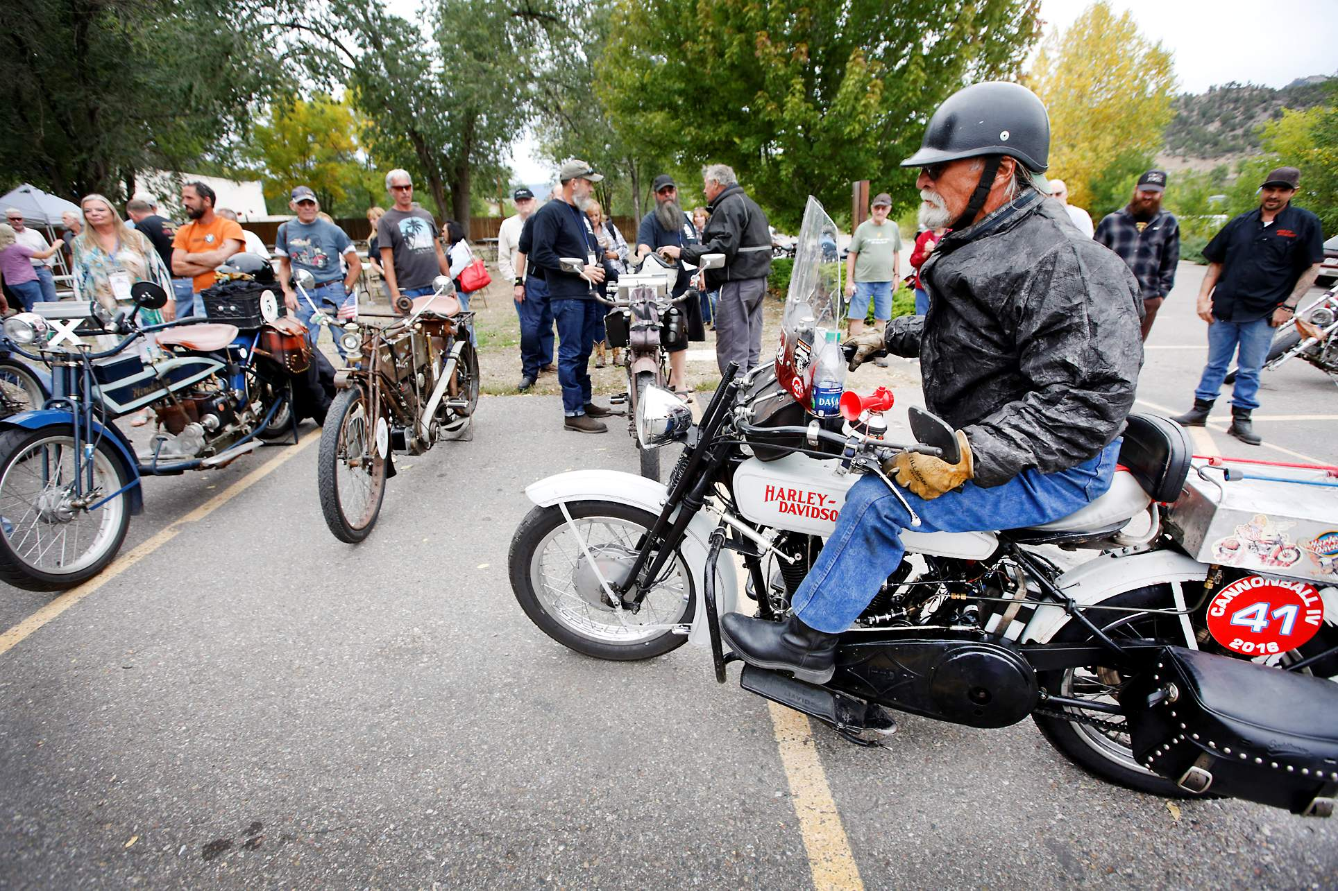 A cross country ride featuring antique motorcycles faced...